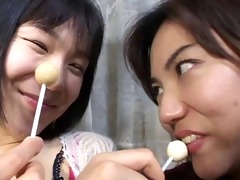 1 cute japanese gals licking lollypops