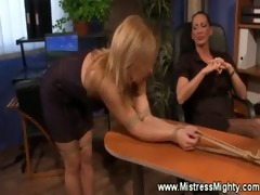 lezdom domme exerts her supremacy