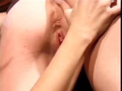 licking lesbo buries vibrator in friends cum-hole