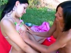 dark brown lesbians engulf in the grass