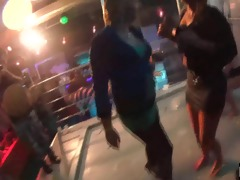concupiscent girls dancing erotically in a club