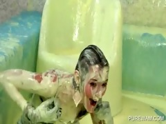 clothed lesbians have fun in a pool of messy paint