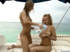 lesbo women bare on a yacht engulfing the nipps