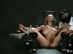 belted breasty golden-haired in gyno chair